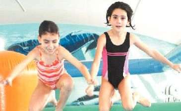 WINTER DIP: Starting their holidays with a splash at the Goonellabah Sport and Recreation Centre are sisters Charlotte and Evie Lopes, of Ballina.