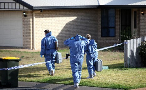 Police at the scene of a fatal shooting at Gracemere.