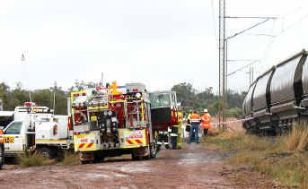 Emergency services crews at the site of the fatal collision between a four-wheel drive and a coal train.