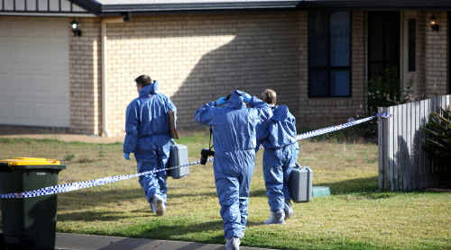 Police enter the house at Gracemere where a shooting took place on Tuesday.