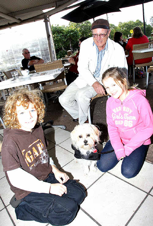 Ernie Sheldon and his pup Susi enjoy the company of Luke Walsh and Montana Murray at a Cotton Tree cafe.