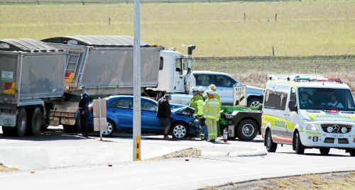 Two cars collided at the Eight Mile intersection yesterday, with one man taken to hospital with chest and neck injuries.