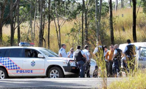 Police on the corner of the Bruce Highway and Gladstone/Mt Larcom Road.
