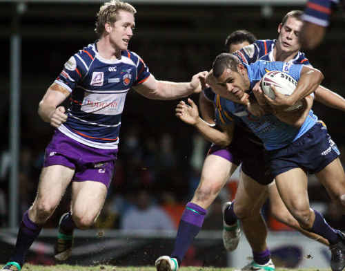 Guy Williams and Chris Beasley stop another Norths attack.