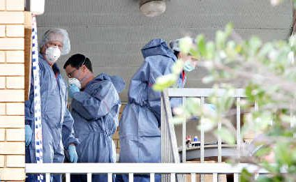 Forensic police officers examine an Alexandra Headland's unit in which Justine Jones lived.