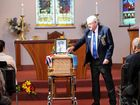 CHAMPION BLOKE: Max Lewis, president of the Ballina RSL Sub-branch, places a red poppy on the coffin of Stan Tilley during yesterday's funeral service at St Mary's Anglican Church in Ballina.