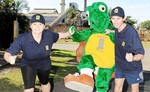 Bonnie Holmes, Ragus the Bundaberg Sugar team mascot and Dean Grummitt get in some training for the fun run.