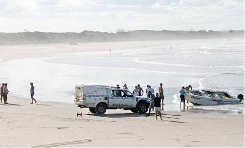 One of the boats swamped on the Evans Head bar was swept 500 metres along the beach.