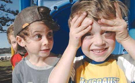 Jet Knight, 5, and Sunny Flynn, 6, playing at Byron Bay.