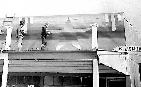 Painting the murals on Nimbim shopfronts in 1973 during the Aquarius Festival.