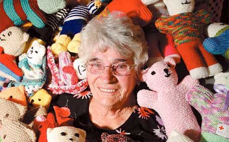 Trauma Teddy convenor Eileen Callow with some of the Trauma Teddies knitted by Sunshine Coast residents.