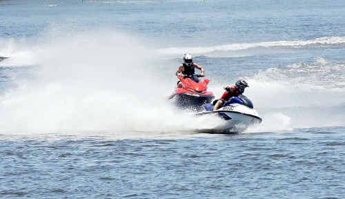 Bundaberg Power Boat Racing Club racer Alan Searle overtakes Jason Hooper in pursuit of Robert West in his last race at Sandy hook.
