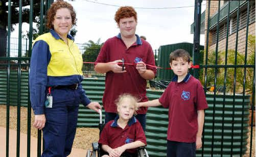 Sharynne Durbridge and Keeley Webb cut the tape while Gemma Evans and Jake look on at the opening the new garden at the Gympie special school