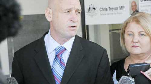 I'M IN FOR FLYNN: Chris Trevor and wife Colleen front the media at a press conference in Gladstone yesterday. Photo courtesy of the Gladstone Observer.
