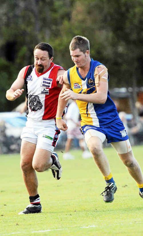 Bulldogs' Rob Searle and Waves' Brendan Prossliner tussle for the ball during the derby.