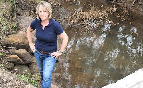 OPEN AND SHUT CASE: Land owner Gill Kube is exasperated over the drains on her property.