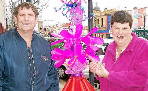 Recycladelic rainbow tree: Blue Care Cooinda Group's Michael Craig and Megan Ballard.