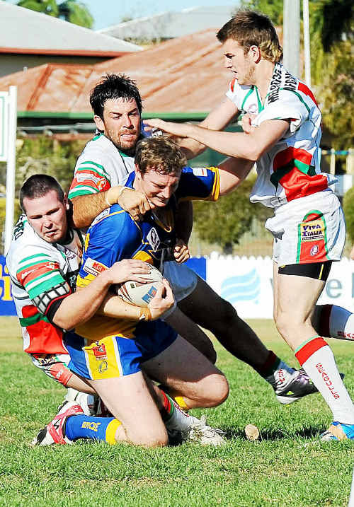 Across the Waves player Brent Louden gets gang tackled by Hervey Bay Seagulls players at Salter Oval. Photo: