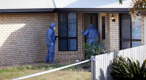 Police enter the property at Gracemere where a baby was shot to death on Tuesday, July 6.