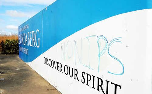"""The seemingly racist graffiti scrawled on the """"Thanks for visiting Bundaberg"""" sign on the Isis highway."""