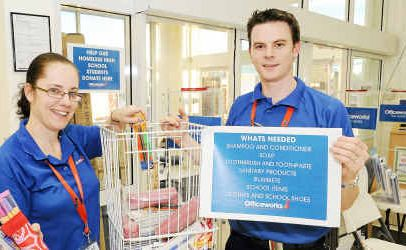 Mel Albert and Shaun Coles of Officeworks have set up a contribution collection point for donations to help Bundaberg's homeless and underprivileged teens.
