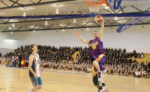 Maroochydore Clippers basketballer Zane Meehl puts on a show at the opening of Sunshine Coast Grammar School's hall.