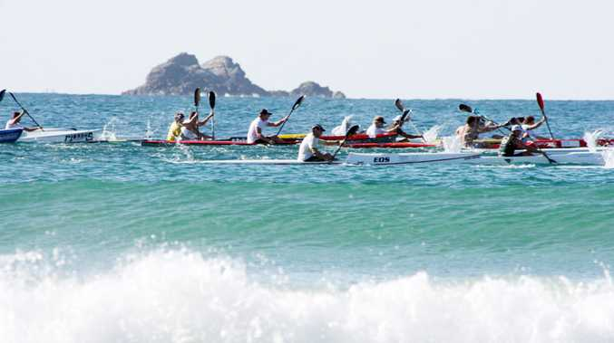 Competitors in Saturday's race put in the big strokes at Main Beach on the way to the cape.