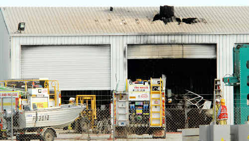 Emergency services rushed to this Paget shed yesterday after an explosion killed a 31-year-old Mackay man.