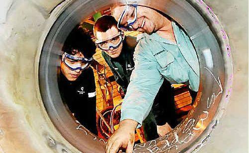 Second year apprentices Glen Nerboni and Glenn Baldwin with apprentice trainer Brad Richardson, right.