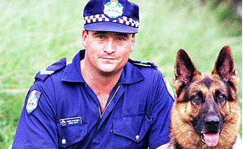 Senior Constable Norm Watt with his dog Zeus.