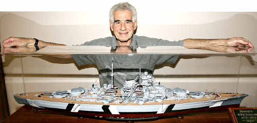 Greatest challenge: Con Stergiopolous shows off his painstakingly-created replica of the World War II German pocket battleship, Bismarck.