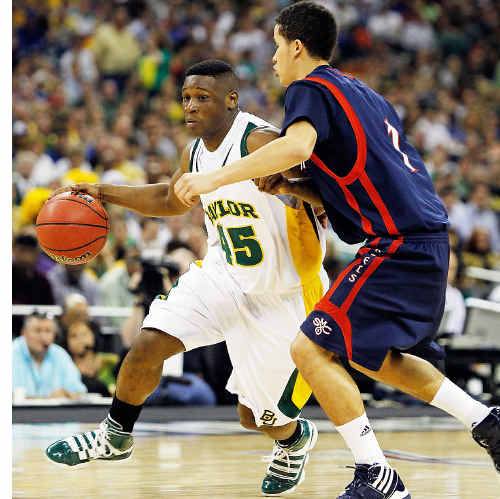 On the big stage: St Mary's Jorden Page, right, gets ready to pressure the Baylor Bears' Tweety Carter at the NCAA tournament last March.