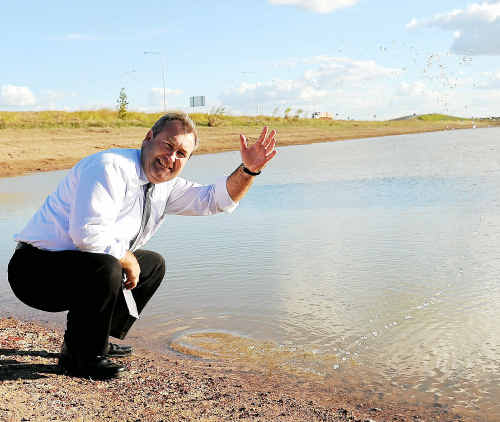 Jack Dempsey considers the water that runs into the detention dam beside the Ring Road to be a wasted resource.