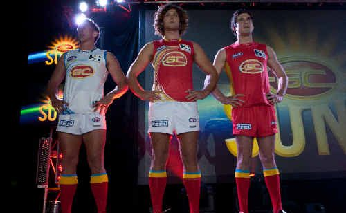 Players show off their new jerseys at the official launch of the Gold Coast Suns this week.