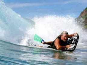 Surf mat on crest of a wave
