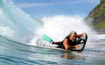 WELCOME BACK MAT: Lennox Head surfer Mark Thomson rides a surf mat off Lennox Point.