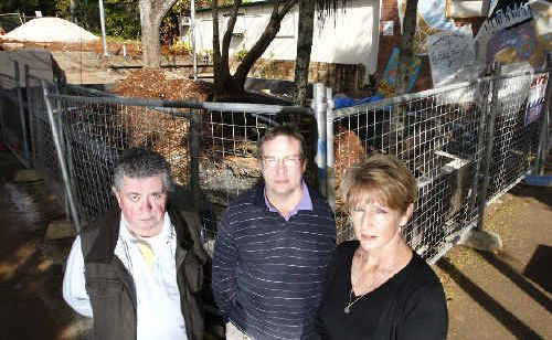 Bangalow Chamber of Commerce president Michael Malloy (left), owner the newsagency next to the park Richard Rombouts, and Bangalow Pharmacy employee Kerry Buchan at the construction site at the Bangalow Park.