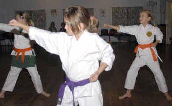Courtney Creagh, Ashley Collinscastle and Paige Einarson practising Shotokan.