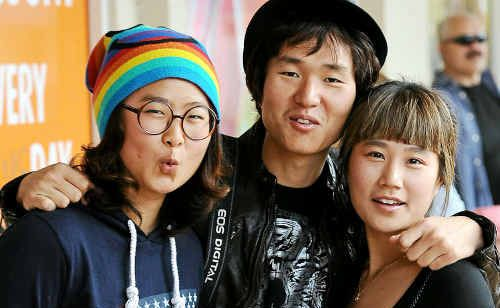 Jenny Kim, Eric Ahn and Elly Maeng enjoy the atmosphere of the Childers festival.