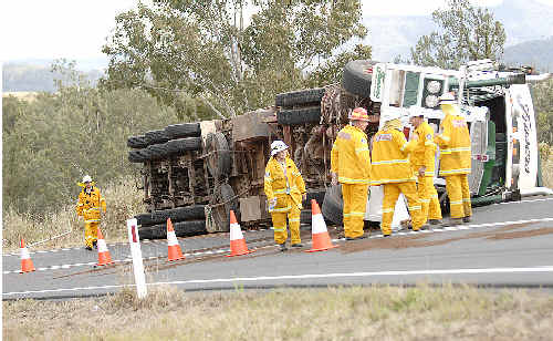 Kyogle rescuers survey the scene where a cattle truck carrying 70 head of cattle tipped while negotiating a bend near Old Grevillea.