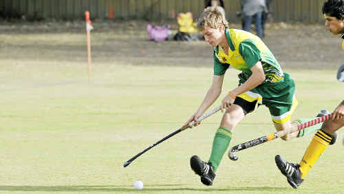 Michael Boyd of Sparks runs with the ball during his Extended League game against Southside at the Gladstone Hockey Fields.