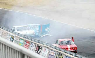 Queensland driver Bob Heagerty (7) suffers damage to his car at Morgan Park Raceway yesterday.