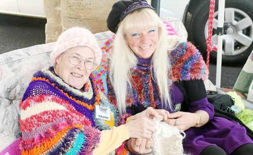 Sue Marshman (left) teaches Sonya Carr to crochet a beanie.