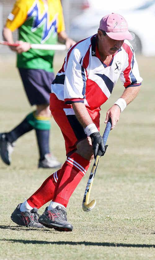John Kirchner of Bundaberg looks to beat a Brisbane player in the Queensland Veteran Men's Hockey Titles.