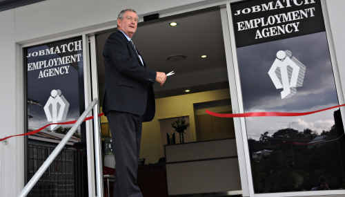 Gympie Mayor Ron Dyne cuts the ribbon to officially open the new Jobmatch Employment Agency building in O'Connell Street, Gympie.