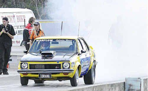 John Jeremy gets his Holden Torana smokin' at Benaraby Raceway on Saturday.