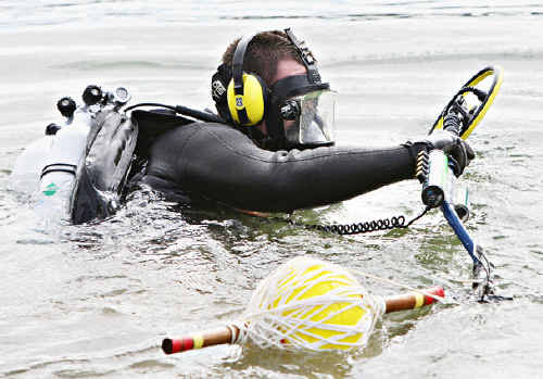 Police divers search the Maroochydore River.