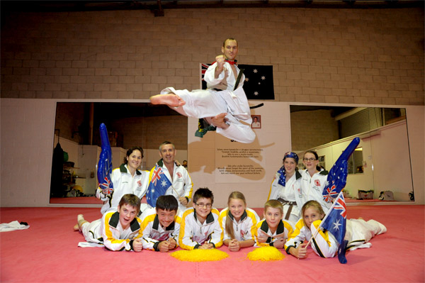The Sunshine Coast Karate Club has 12 students representing Australia in the Chito-Ryu World Championships. Pictured are Martin Phillips (flying through the air), (back L-R) Sandra Phillips, Jim Moehead, Emma Moehead, Helen O'Grady and (front L-R) James O'Grady, Viet Kaas, George Britchford, Tia Guy, David Strazzari and Emma Woodhouse.