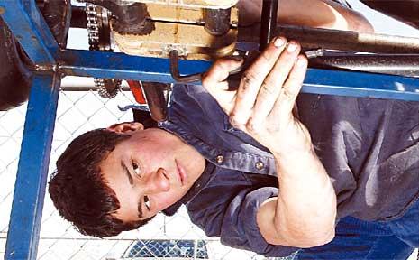 Morgan Vandesande, 15, works on a go-kart at the Lismore Go Kart Club track.