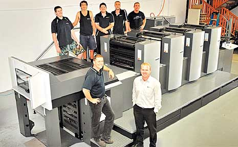 GT Print owners Graham Hart (left) and Craig Mulligan, with staff members (back left to right) Peter, Wes, Waldo, Micky and Camo, and the new $1 million machine.